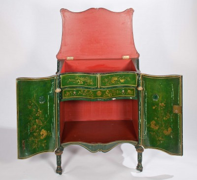 Interior of japanned Chippendale nightstand.