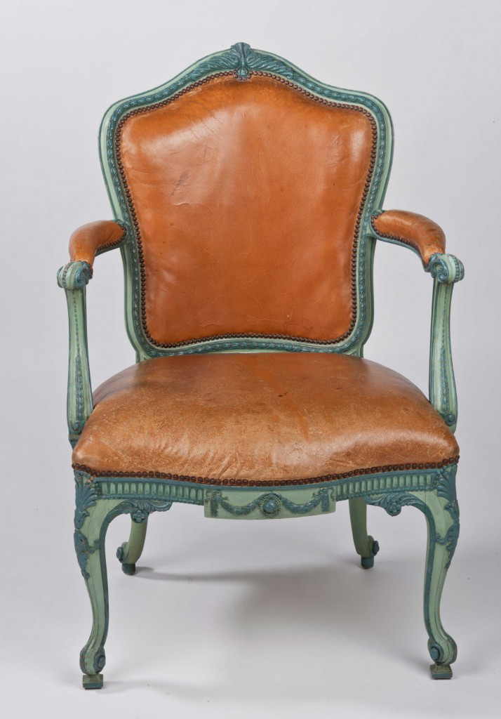 Open arm chairs created by Thomas Chippendale