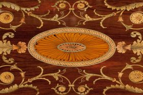 Detail of inlaid Chippendale table top