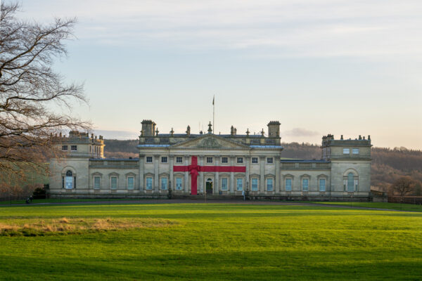 Harewood House at Christmas with a red bow on the front of the house